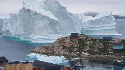 According to local media, police asked villagers who live closest to the water, to leave their houses over fears the iceberg could calve and affect the village with a tsunami. (AAP)