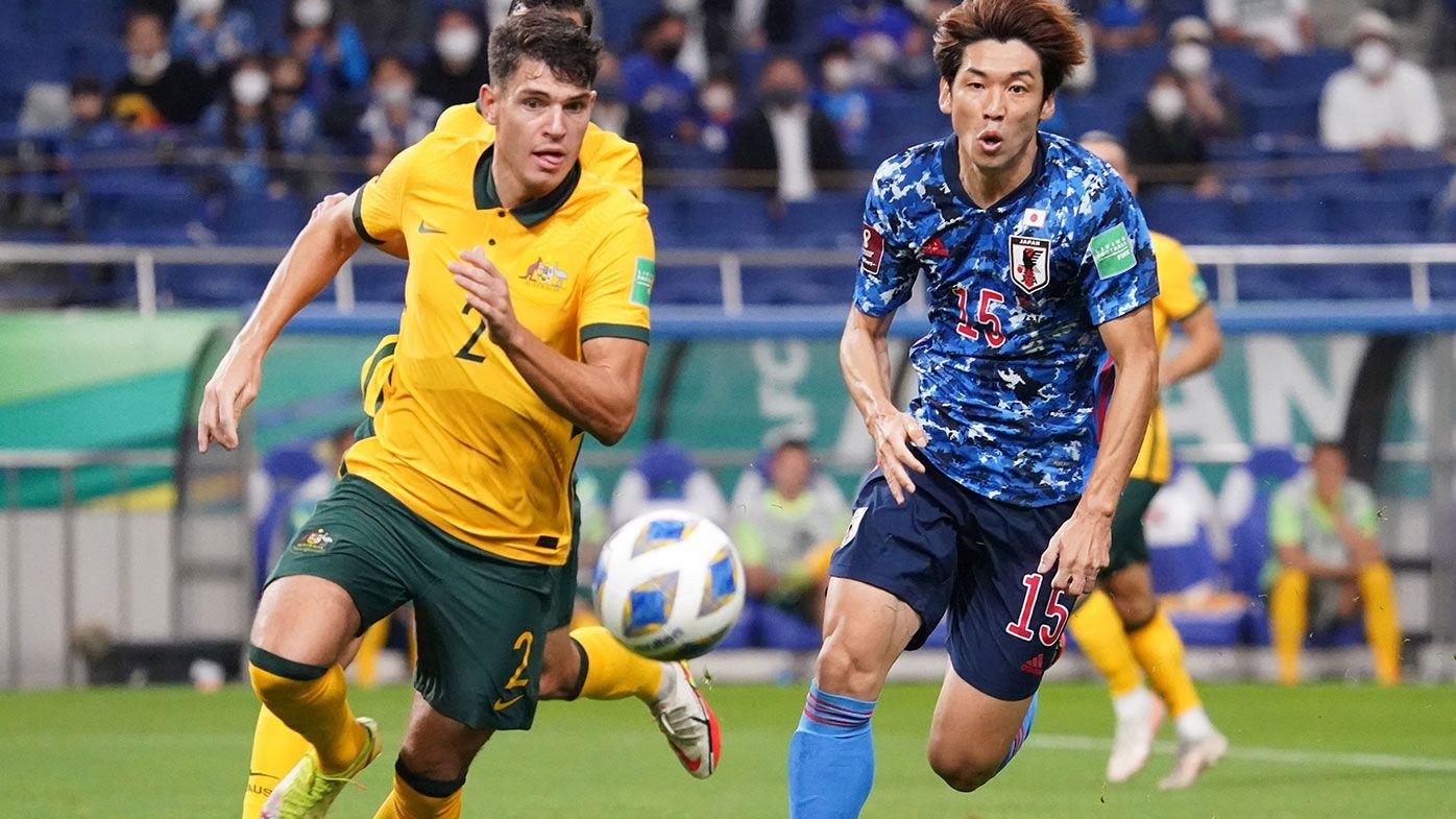 Fran Karacic of Australia and Yuya Osako of Japan compete for the ball