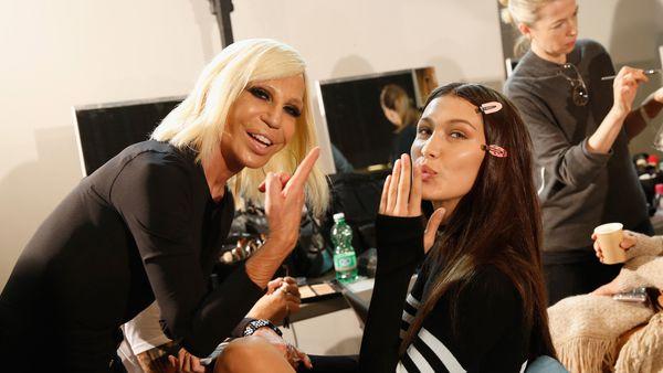 Donatella Versace backstage with Bella Hadid.
