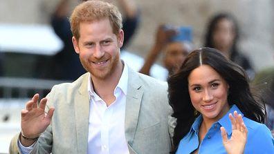 Prince Harry and Meghan Markle waving to crowd