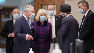 Prince Charles, Prince of Wales and Camilla, Duchess of Cornwall talk with with Chief Pharmacist Inderjit Singh as Health Secretary Matt Hancock looks on during a visit to The Queen Elizabeth Hospital on February 17, 2021 in Birmingham, England.