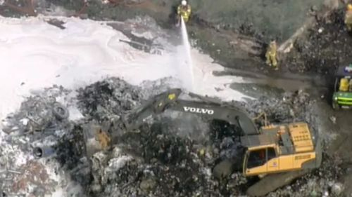 Fire crews used excavators to pull apart recycling, in order to fight the blaze. (9NEWS)
