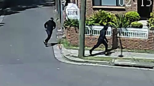 Two men were captured on CCTV running through a nearby street. (NSW Police)