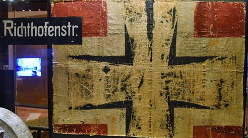 A section of fabric showing the German national insignia, taken from one of the wings of Manfred von Richthofen's Fokker triplane on display at the Australian War Memorial in Canberra. (AAP).
