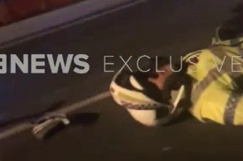 A witness who spoke exclusively to 9NEWS said the officers slid for at least 30 metres on the wet pavement. (Supplied)