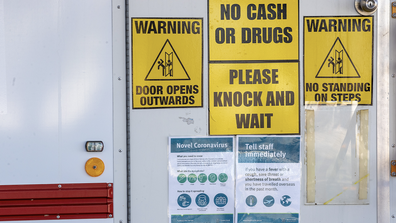 Signage cautioning against the coronavirus (COVID-19) are seen on a dental clinic van at Surfers Paradise on July 15, 2020 in Gold Coast, Australia.