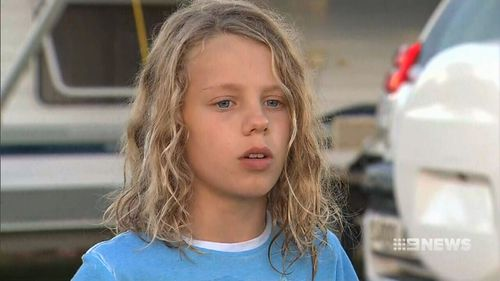 Jordan Spraggs, 11, is lucky to be alive after a deep hole he was digging in sand on a beach south of Adelaide collapsed on him. Picture: 9NEWS.