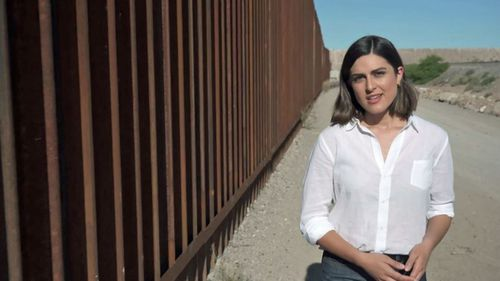 Sarah Abo alongside the wall outside El Paso.