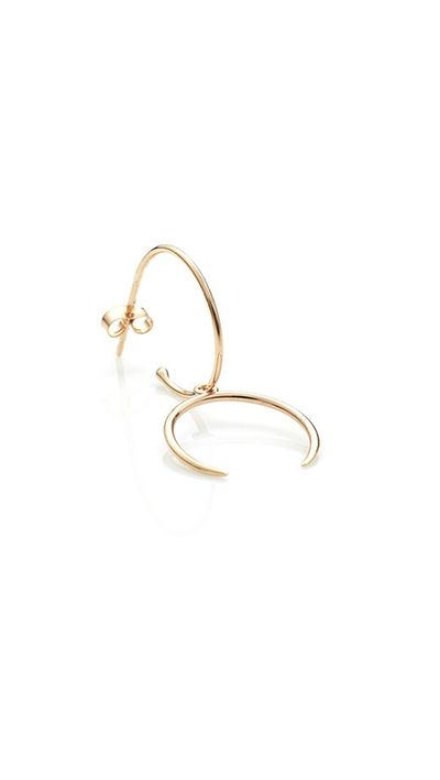 "<p><a href=""http://store.sarahandsebastian.com/products/aura_earring_yellow_gold"" target=""_blank"">Earring, $235, Sarah &amp; Sebastian</a></p>"