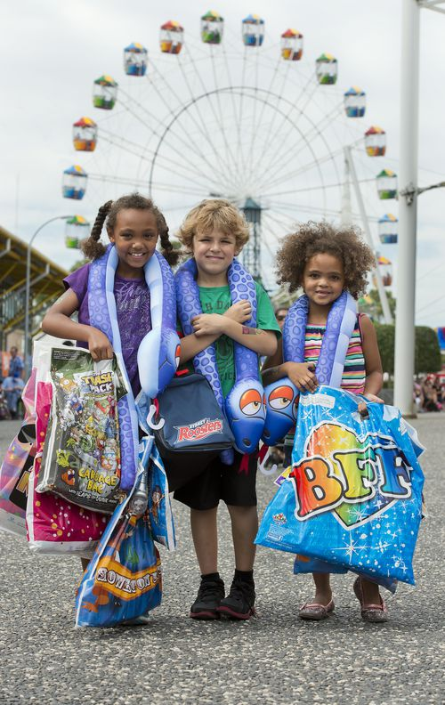 Children with showbags at the Royal Easter Show in Sydney. (AAP)