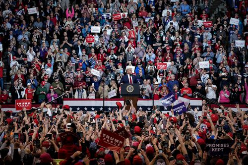 """Supporters cheer as then US President Donald Trump arrives for a """"Keep America Great"""" rally at Southern New Hampshire University Arena on February 10, 2020."""