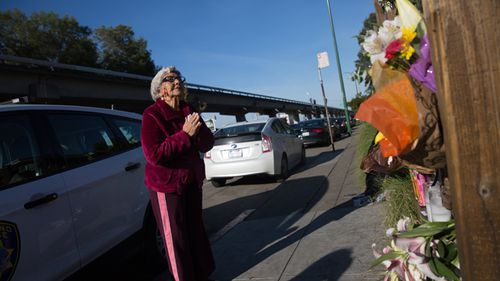 Lidia Marquez says a prayer December 4, 2016 for the victims near the site of a warehouse fire in Oakland, Califonia.