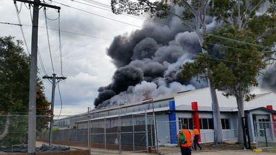 Workers were evacuated across nearby industrial sites as the fire threatened to spread. (Chris Leris)