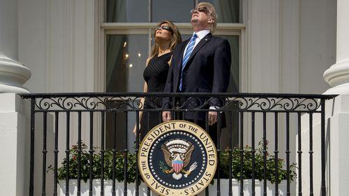 President Trump and first lady Melania Trump watch the solar eclipse at the White House on Aug. 21, 2017. Photo: AP