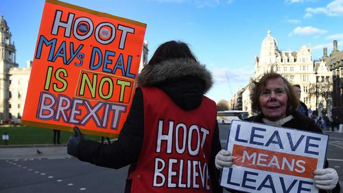 Brexiteers protest Theresa May's latest Brexit deal.
