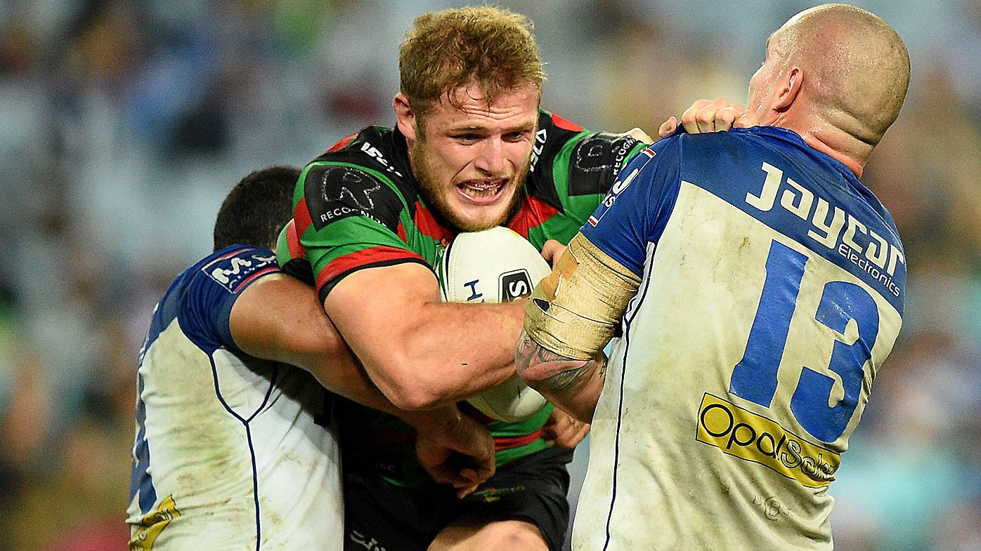 Thomas Burgess of the Rabbitohs is tackled by David Klemmer of the Bulldogs