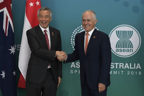 Singapore Prime Minister Lee Hsien Loong and Australian Prime Minister Malcolm Turnbull pose for a photograph following the Singapore-Australia Annual Leaders' Dialogue. Picture: AAP