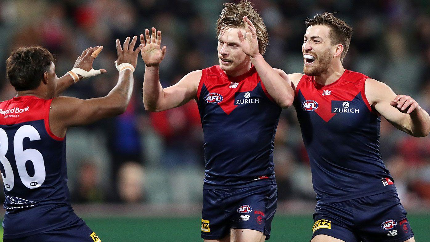 Demons blitz Lions to advance to prelim final