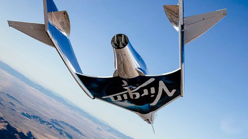Virgin Galactic's tourism spaceship climbed more than 82 kilometres high above California's Mojave Desert today, reaching for the first time what the company considers the boundary of space.