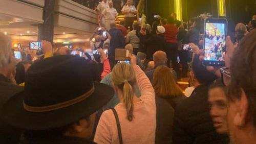Passengers gathered in the atrium of Norwegian Spirit cruise ship on Monday to protests skipped ports of call.