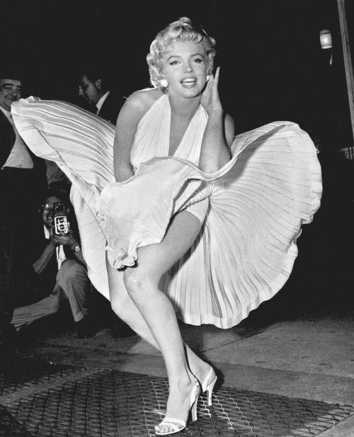 Marilyn Monroe poses over a subway grating in New York during filming for The Seven Year Itch in 1954.
