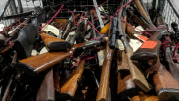 Police seized weapons including an assault rifle, shotguns, a machine gun, pistols, silencers, crossbows, a dagger, as well as