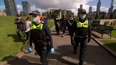 Police escort protester