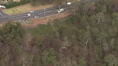 The car slid up to 80m down the hill on a lookout. (9NEWS)