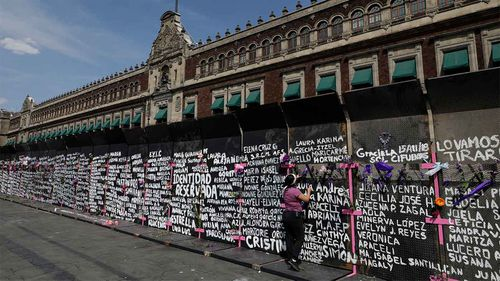 The names of murdered and missing women are written on a wall in Mexico City.