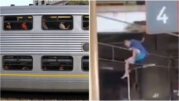 Train commuters have faced lengthy delays after a man was filmed standing on overhead wires at Redfern station.