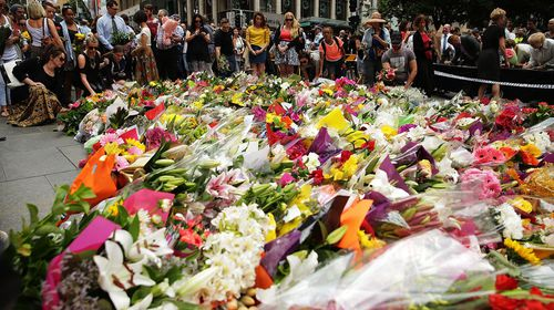 Mourners create of sea of colour in Sydney's Martin Place. (Getty)
