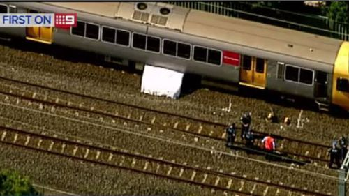 CCTV footage captured the man trainsurfing and attempting to graffiti the back of a train near Runcorn. (9NEWS)
