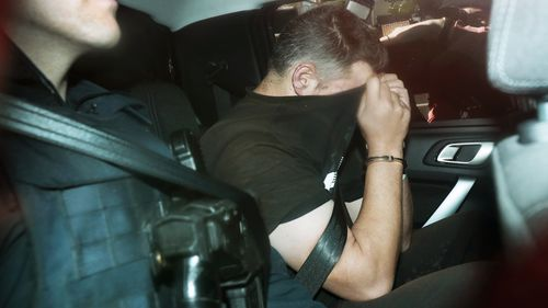 The fugitive Jonathan Dick is taken to the police headquarters after his arrest in Melbourne.