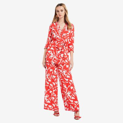 "<p><a href=""https://www.seedheritage.com/p/pyjama-blouse/5801033-964-06-se.html"" target=""_blank"" draggable=""false"">Seed Pyjama Blouse in Royal Red Floral, $129.95</a></p> <p><a href=""https://www.seedheritage.com/p/printed-drape-pant/5806009-964-10-se.html#start=1"" target=""_blank"" draggable=""false"">Seed Printed Drape Pant in Royal Red Floral, $129.95</a></p>"