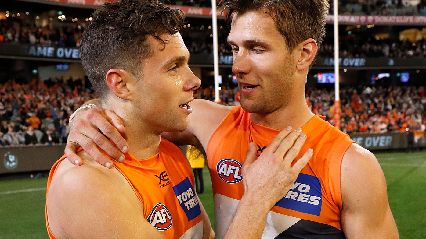 Josh Kelly (left) and Matt de Boer of the Giants celebrate during the 2019 AFL First Preliminary Final