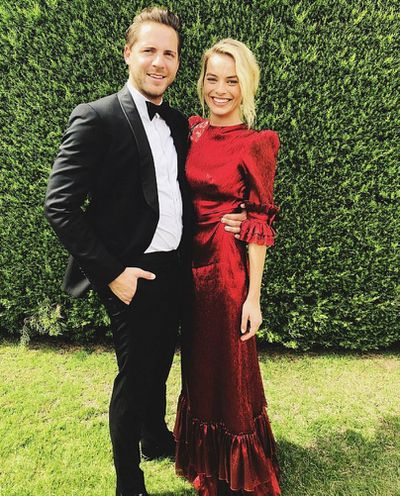 "<p>Actress <a href=""https://style.nine.com.au/2018/01/29/15/48/margot-robbie-style-red-carpet-looks"" target=""_blank"" draggable=""false"">Margot Robbie</a> turned heads big time when she snuck into Melbourne for the nuptials of close friends over the weekend.</p> <p>Her husband, Tom Ackerley, took to Instagram to share photos of himself and the Oscar-nominated star as they headed off to the wedding.</p> <p>The <em>I, Tonya</em> actress wowed in a stunning metallic red gown from designer The Vampire's Wife.</p> <p>This isn't the first time a guest has stolen the show at a friend's <a href=""https://style.nine.com.au/2018/02/23/13/41/wedding-hair-pinterest"" target=""_blank"" draggable=""false"">wedding</a>, click through to see other celebrity guest appearances that have made an impact…</p>"