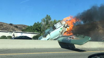 Vintage plane crashes, catches fire on California freeway