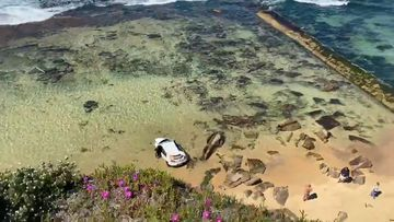 Car crashes on Bar Beach in Newcastle after driving off a cliff.