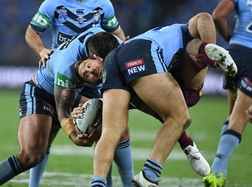 Ben Hunt is upended a Blues pair. Picture: AAP