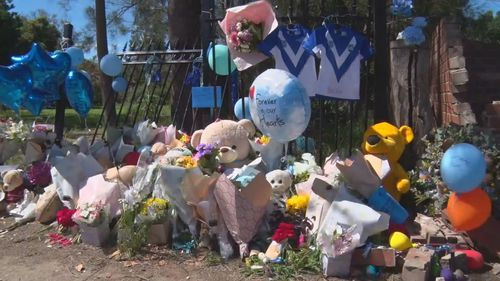 Gifts and balloons have been left at the crash site in Wellington, NSW.