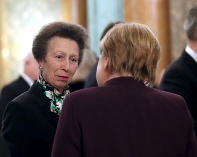 Princess Anne speaking with German chancellor Angela Merkel at the NATO summit.