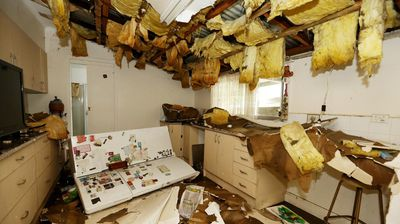 Damage and destruction inside Pauline Cambourne's Dungog home. (AAP)
