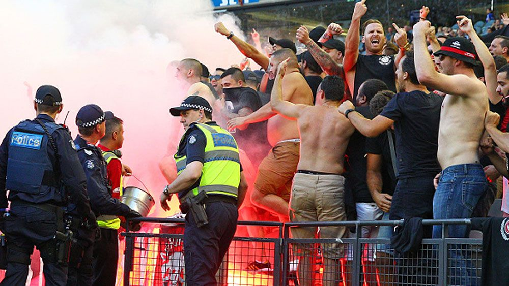 Police keep a watch on Wanderers fans. (Getty)