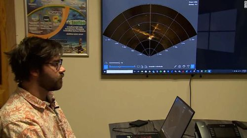 Jeff Riley of Seafloor Systems displays a sonar image of the the airplane wreckage in Folsom Lake.