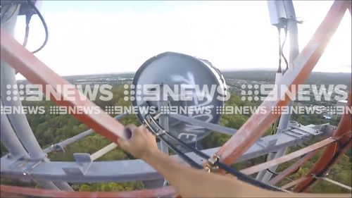 The teens scaling the 34m tall structure at Parkwood without any safety equipment. (9NEWS)