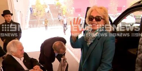 Ms d'Alpuget was all smiles as she left the Langham with her husband. (9NEWS)