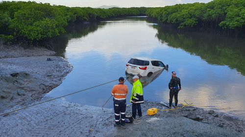 Posting photos of the 2000kg catch online, Queensland's Department of Transport and Main Roads said the car, a brand-new Isuzu MUX was retrieved from McCreadys' Creek last month.