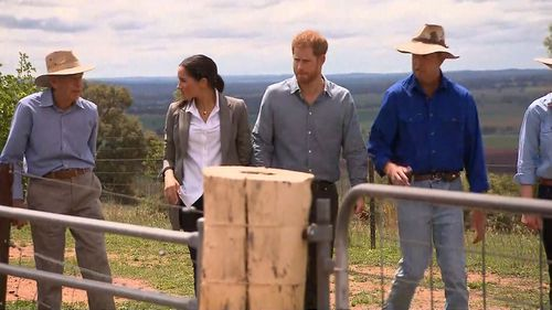 The Duke and Duchess of Sussex touring the Woodley family farm.