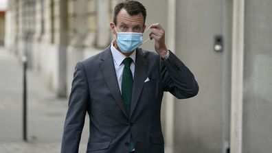 Denmark's Prince Joachim adjusts his face mask as he walks to work, at the Danish Embassy in Paris, France on Friday, September 18, 2020