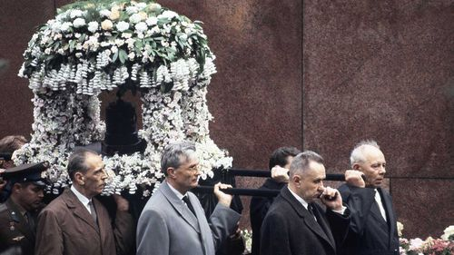 Yuri Gagarin's remains are carried by Soviet leaders as part of his funeral procession in Moscow.